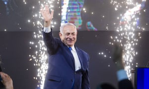 Netanyahu greets supporters on election night in Tel Aviv.