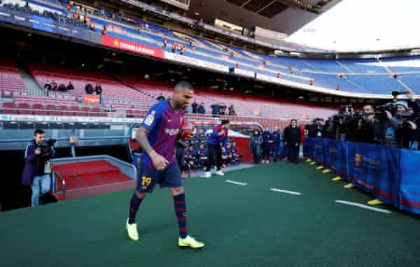 Boateng walks out for his unveiling at the Camp Nou