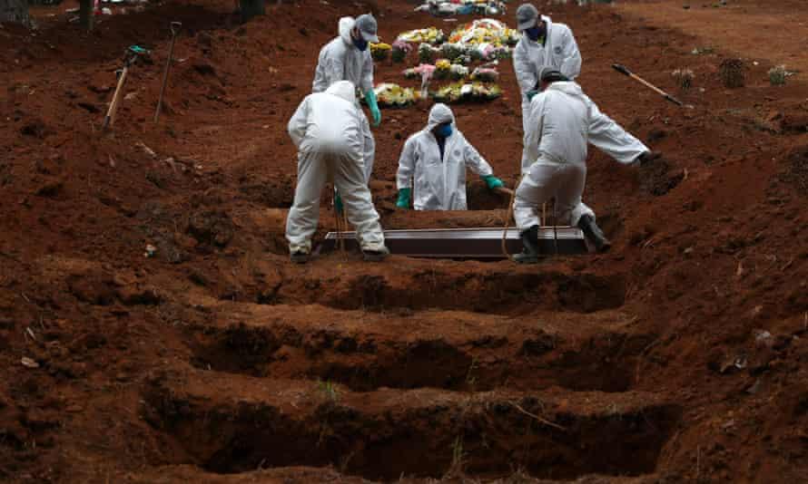 Gravediggers wearing protective suits bury a coronavirus victim in Sao Paulo, Brazil.