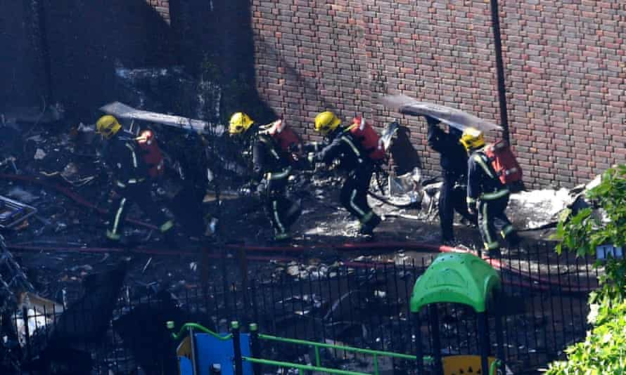Firefighters at the scene of the Grenfell Tower fire.
