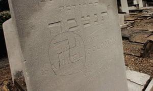 A swastika is daubed on a Jewish gravestone