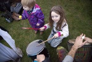Children play instruments at Stonehenge