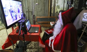 A person dressed as Samichlaus (Swiss Santa) interacts with children via video at a studio of the St. Nikolausgesellschaft Zurich, as the spread of the coronavirus disease (COVID-19) continues, in Zurich, Switzerland.