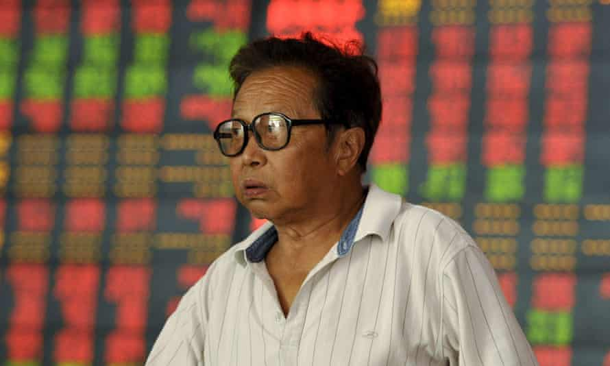 An investor in front of a stock information board in Fuyang, Anhui province, China