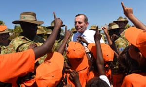 Tony Abbott with military personnel and children at Yirrkala on the Gove Peninsula, Northern Territory, in 2014 fulfilling his pre-election promise to spend time in remote Indigenous communities.