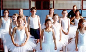 A scene from Billy Elliot showing a class full of girls and Billy.