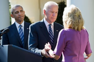 President Barack Obama watches as Vice-president Joe Biden turns to his wife Dr Jill Biden after announcing that he will not run for the presidential nomination on 21 October 2015.