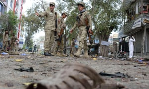 Afghan security personnel at the scene of a suicide attack in Jalalabad. A high court judicial review is due to take place on whether deportations to Afghanistan remain safe in view of the worsening security situation