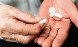 Old woman with pills. medication, old age. pensioner