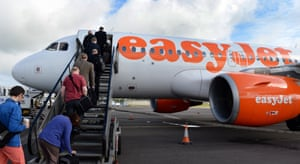 Passengers board an airplane of low cost carrier Easyjet in Belfast, Northern Ireland.