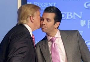 Donald Trump kisses his son Donald, Jr. at a campaign event at Regents University in Virginia Beach, Virginia.