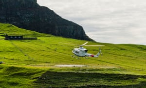 Helicopter landing in Mykines in the Faroe Islands