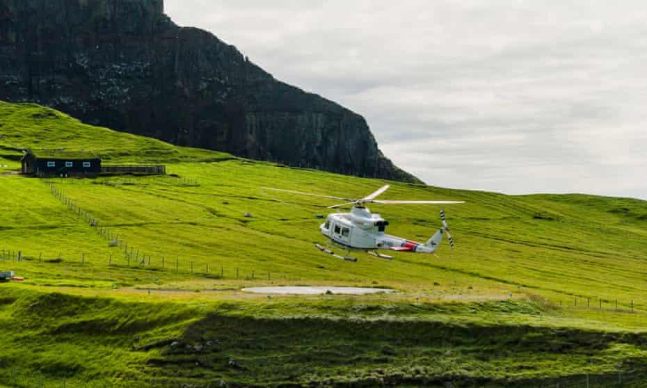 Helicopter landing in Mykines in the Faroe Islands