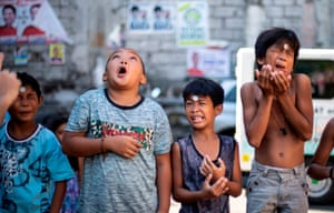 Boys participate in a game in Manila, Philippines, on the feast day of St Rita of Cascia