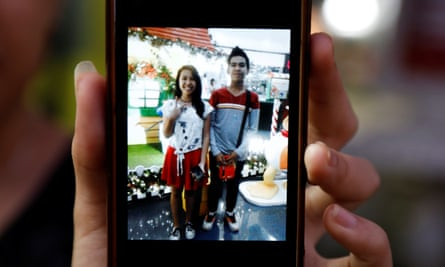 Kian delos Santos's sister Shirley shows a picture of them together on her phone