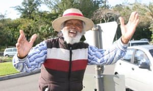 Johnny Barnes greeting commuters from his roundabout in Bermuda.