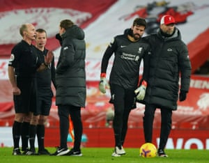 Liverpool's manager Jürgen Klopp (right) consoles Alisson after the keeper remonstrated with referee Mike Dean about the penalty decision, a job now taken on by Liverpool's assistant manager Pepijn Lijnders.