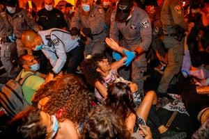 Police evacuate protestors blocking a main road outside Netanyahu's official residence