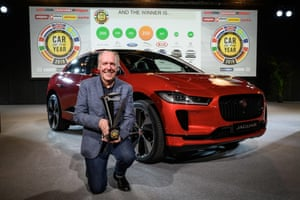 Jaguar design director Ian Callum poses next to the I-Pace model, which was awarded European Car of the Year 2019