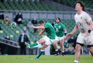 Ireland's Johnny Sexton thumps the ball between the sticks.