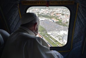 Francis looks at the crowd gathering in the Sanctuary of Our Lady of Fátima from the window of his helicopter.