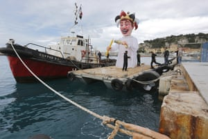 Nice, France: Workers remove the King of Nice carnival float