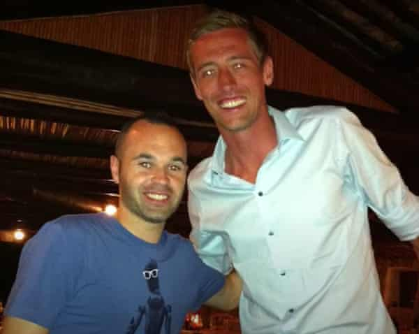 Peter Crouch's holiday snap with Andrés Iniesta that is the subject of a running jokes in his podcast.