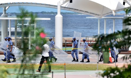 Maldives police patrol the streets of the capital Male. Authorities say they are stepping up searches for explosives following an alleged assassination attempt on President Abdulla Yameen.