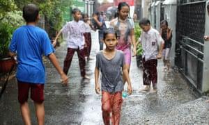 kids playing outside in rain