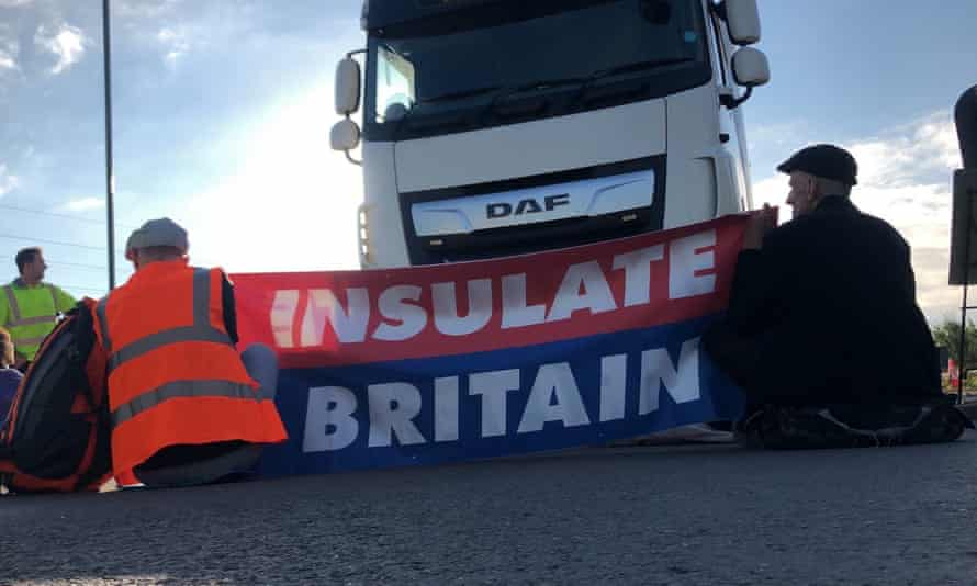 Protesters taking part in blocking the M25 motorway in London