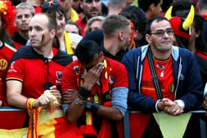 Supporters of Belgium react after the match.