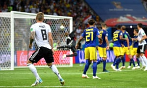 Toni Kroos watches as his stunning  free-kick beats the despairing dive of Sweden's goalkeeper Robin Olsen to seal Germany's victory with almost the last kick of the game.