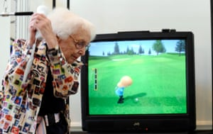A player enjoys a round of golf on the Nintendo Wii in 2008.