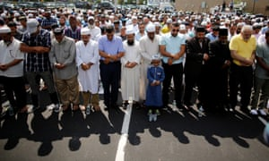Community members pray during the funeral service of Akonjee and Uddin in the Queens borough of New York City.