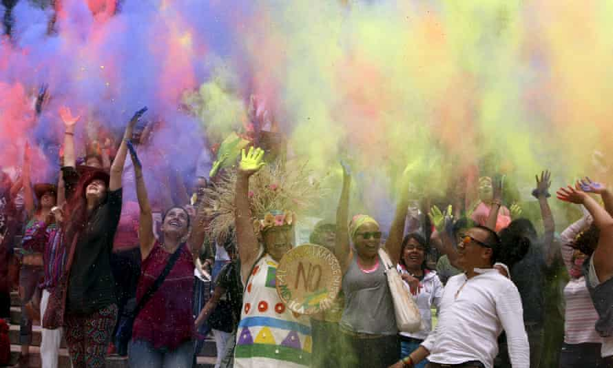 Coloured powder symbolising glyphosate-containing herbicide is thrown during a May 2015 protest against Monsanto in Mexico City