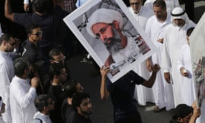 Saudis carry a poster of Sheikh Nimr al-Nimr last May as they protested for him to be released