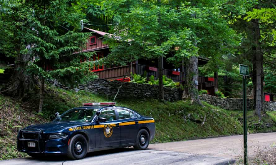 A New York State Trooper stands guard outside the home where Roy Den Hollander was found dead after allegedly killing the son of federal judge Esther Salas.