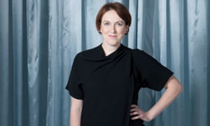 Kate Devlin, hand on hip, grinning