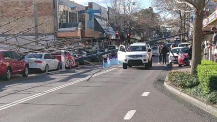 Scaffolding collapses on cars in Gosford on Wednesday.