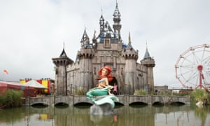 A mermaid and castle by Banksy at Dismaland.