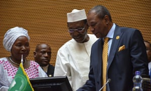President Idriss Déby of Chad, centre, hands over to the new African Union chairman, President Alpha Conde of Guinea, right, with former head of the AU Nkosazana Dlamini-Zuma, left, at the summit in Addis Ababa, Ethiopia.
