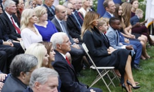 Karen and Mike Pence sit across the aisle from Melania Trump and Barrett's family as Barrett speaks.