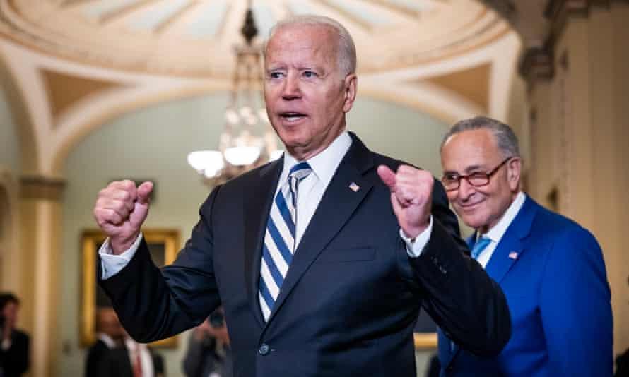 Joe Biden departs a Democratic Senate luncheon with Chuck Schumer in Washington DC.