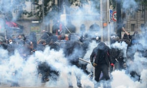 Masked men clash with riot police during a demonstration against labour reforms in Nantes, western France.