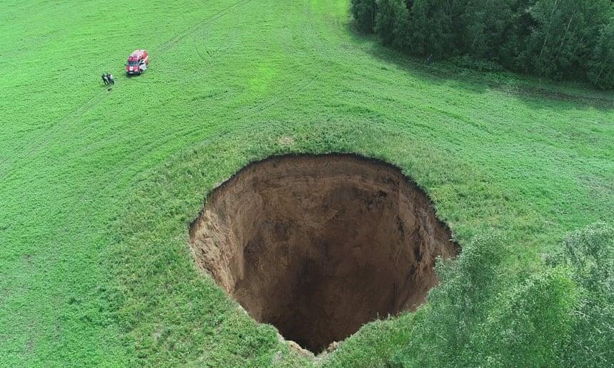 A 50m-deep sinkhole in the Nizhny Novgorod region of Russia. Photograph: Tass