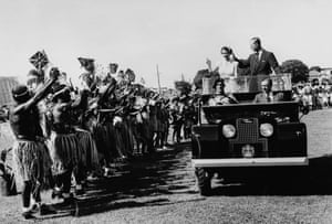 Queen Elizabeth II And Prince Philip In AustraliaQueen Elizabeth II and Prince Philip, Duke of Edinburgh wave to a group of traditionally dressed aborigines, who are holding up Union Jack Flags, as the royal couple stand in the back of the Royal Land Rover in Townsville, Australia in March 1954. (Photo by Paul Popper/Popperfoto/Getty Images)
