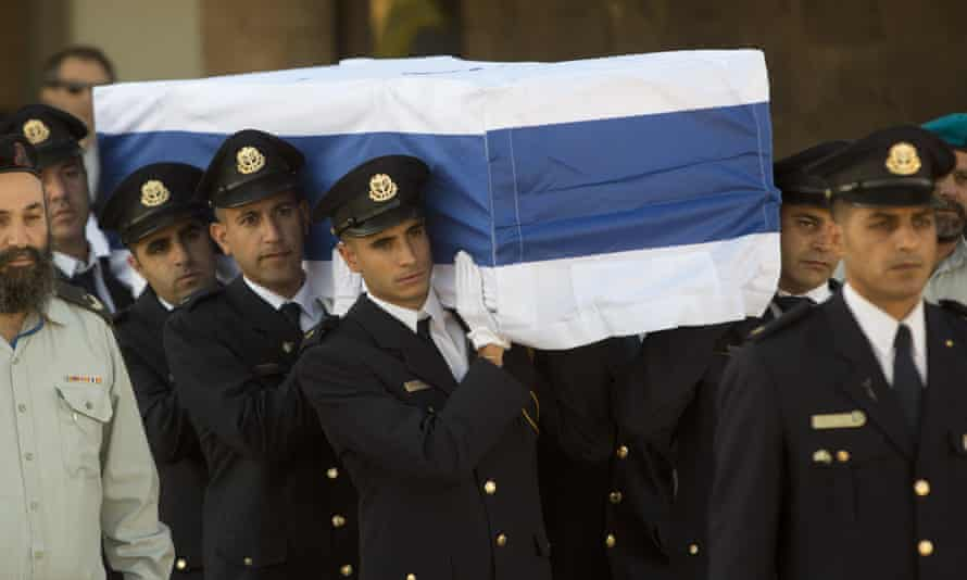 Members of the Knesset guard carry the coffin of Shimon Peres at the Knesset in Jerusalem on Friday