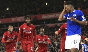 Liverpool forward Divock Origi, second from left, celebrates after scoring a late winner against Everton.