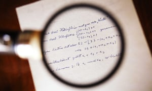 Albert Einstein's manuscripts at Rootenberg books in Sherman Oaks, California, USA. They belong to the estate of Ernst Straus who was a long-time mathematical collaborator with Einstein and are going on sale in London next week.   The equations in the round magnifying glass are his calculations about a card trick. maths mathematics formula