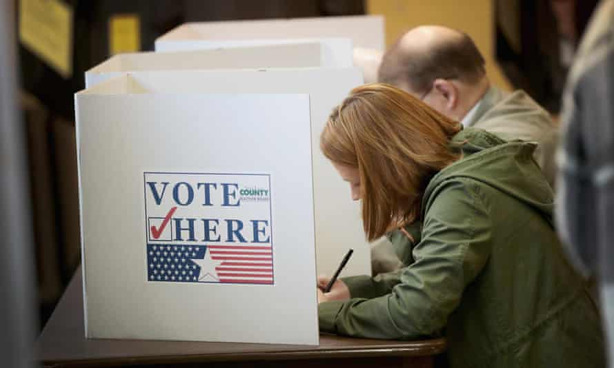 A woman casts her ballot in the midterm election on 6 November.